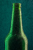 Cold beer bottle with drops Stock Images