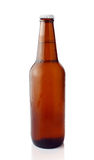 Cold beer in brown bottle Stock Images