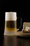 Cold beer and cheese Stock Photos
