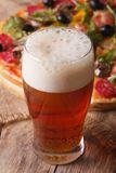 Cold beer closeup on a background of pizza, vertical Stock Photo