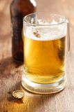 Cold beer glass on bar or pub desk Stock Image