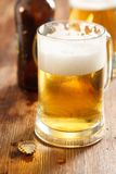 Cold beer glass on bar or pub desk Stock Photos