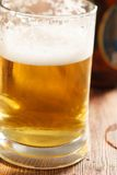 Cold beer glass on bar or pub desk Stock Images