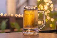 Cold beer glass on a bar scene in the background royalty free stock photos