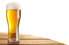 Cold beer glass on the bar table. Clipping paths. Beer glass on the bar table isolated on a white. Contains clipping paths Stock Photography