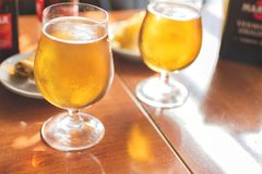 Glasses of cold beer with delicious tapas royalty free stock photo