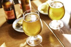 Glasses of cold beer with delicious tapas royalty free stock image
