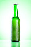 Cold beer in green bottle with a condensate Royalty Free Stock Photo