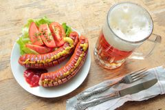 Cold beer with grilled sausages Stock Photos