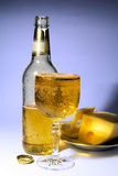 Cold beer in the misted over glass. Cold beer and cheese Royalty Free Stock Photos