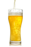 Cold beer pouring into glass Royalty Free Stock Photos