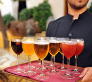Cold beer and soft drinks, bartender, catering service. Waiter serving cold beer and soft drinks tray, catering service at a meeting, Spain Royalty Free Stock Photography