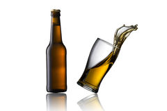 Cold beer spill. Glass of cold beer spill on white royalty free stock image