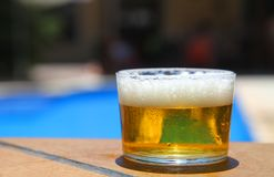 Cold beer in a swimming pool Royalty Free Stock Photo