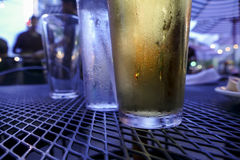 Cold beer on table Stock Images