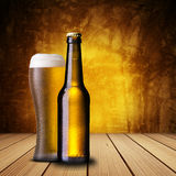 Cold beer on wood table Stock Photography