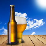 Cold beer on wood table Royalty Free Stock Photos