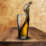 Cold beer on wood table Stock Image