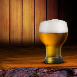 Cold beer on wood table Royalty Free Stock Images