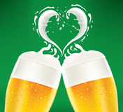Cold beerglass with foam like heart Royalty Free Stock Photo
