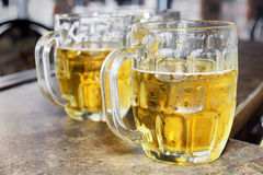 Cold beers in glass bocks Stock Photo