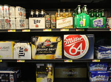 Cold beers on store shelf Royalty Free Stock Photography