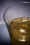 Cold Beverage in a Glass on ice. Closeup Royalty Free Stock Image