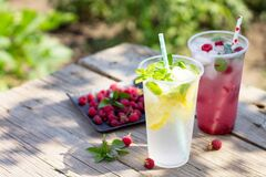 Free Cold Beverage. Refreshing Summer Drink Lemon, Refreshing Summer Drink Raspberry With Basil And Ice Stock Image - 191259721