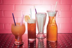 Cold beverages. Four Glasses of cold beverages Stock Photo