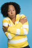 Cold Black Woman. Cold shivering black winter woman royalty free stock image