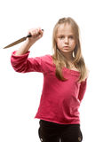 Cold blooded little girl with knife Royalty Free Stock Photos