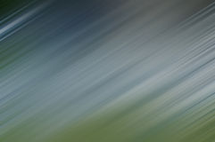 Cold-blue and green blurred lines in diagonal direction Stock Images