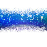 Cold Blue Holidays background with snowflakes Royalty Free Stock Image
