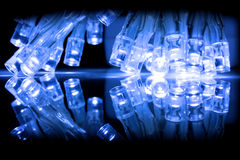 Cold blue LED lights closeup with reflection Royalty Free Stock Photography