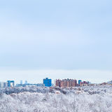 Cold blue sky over town and snow woods in winter Stock Photo