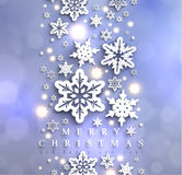 Cold blue sparkling Christmas background with snowflakes Stock Images