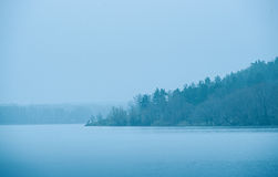 Cold blue toned lake in winter Stock Photos
