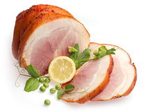 Cold boiled pork decorated with lemon and pea. Cold boiled pork decorated with lemon and green pea over white background Stock Photography
