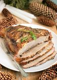 Cold boiled pork is a traditional Russian, Austrian or German dish of meat with spices and garlic. Christmas decoration, rustic st. Yle, selective focus Royalty Free Stock Photo