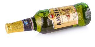 Cold bottle of Amstel Premium lager beer on white background. CHISINAU, MOLDOVA - March 16, 2018: Cold bottle of Amstel Premium lager beer on white background royalty free stock photography
