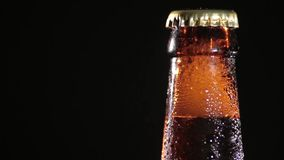 Cold Bottle of Beer on Black Background Royalty Free Stock Image