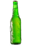 Cold bottle of beer with ice Royalty Free Stock Image