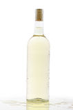 Cold bottle of white wine Stock Images