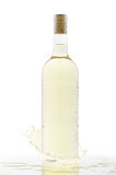 Cold bottle of white wine with a splash Royalty Free Stock Photography