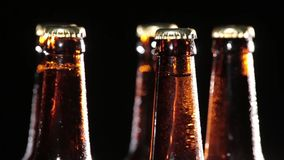 Cold Bottles of Beer on Black Background stock video footage
