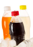 Cold bottles of soda in ice Stock Images
