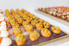 Cold buffet for party. Small various bruschetta arranged for the cold buffet Royalty Free Stock Photos