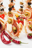 Cold buffet with prosciutto and olives Royalty Free Stock Photography