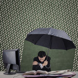 Cold businessman working with umbrella Royalty Free Stock Photos