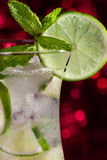 Cold Caipirinha with fresh lime slices Stock Images